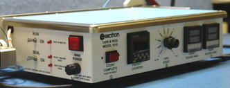 Exatron tape and reel tube feed with automatic hot sealling